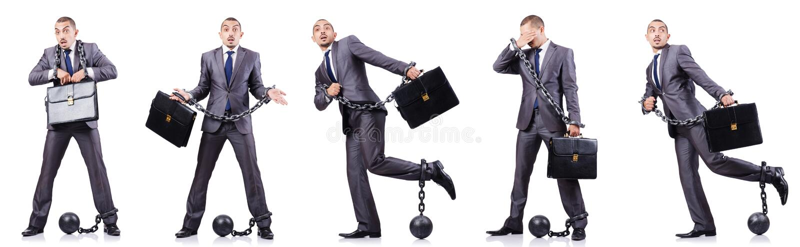 L'homme d'affaires avec des dispositifs d'accrochage sur le blanc photo stock