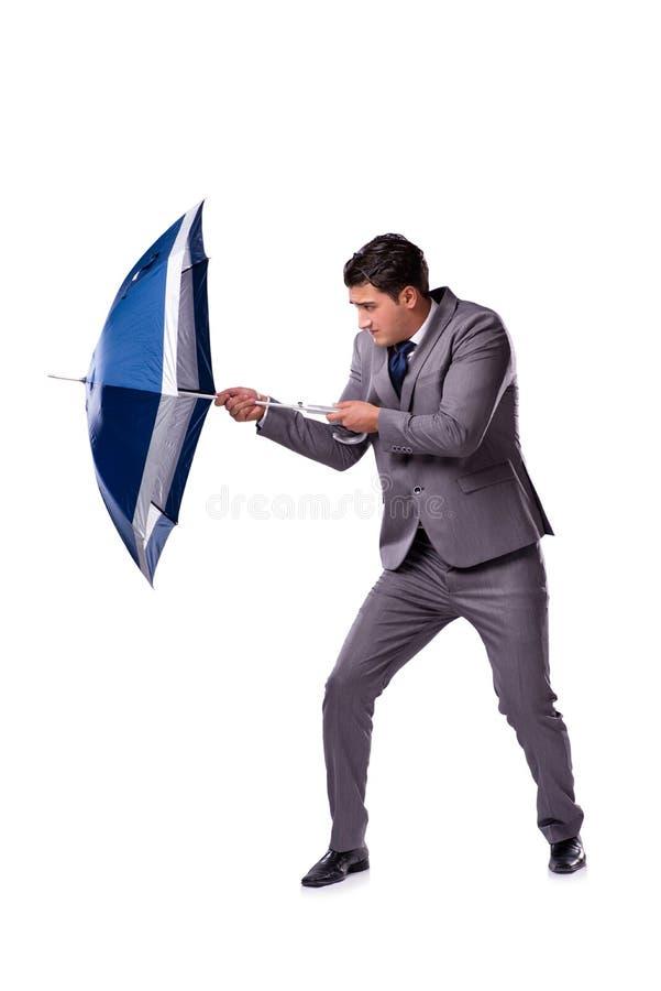 L'homme d'affaires avec le parapluie d'isolement sur le fond blanc image libre de droits