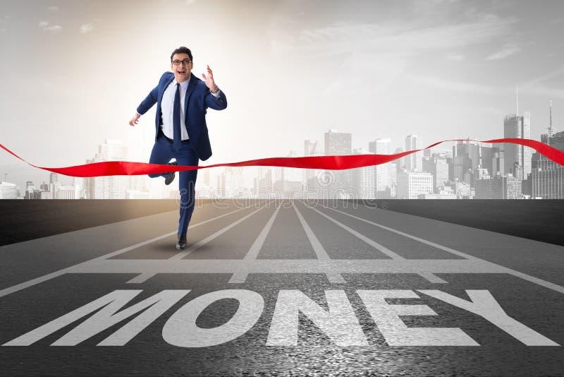 L'homme d'affaires courant vers l'argent sur la voie photographie stock libre de droits