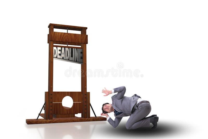 L'homme d'affaires dans le concept de date-butoir avec la guillotine photo libre de droits