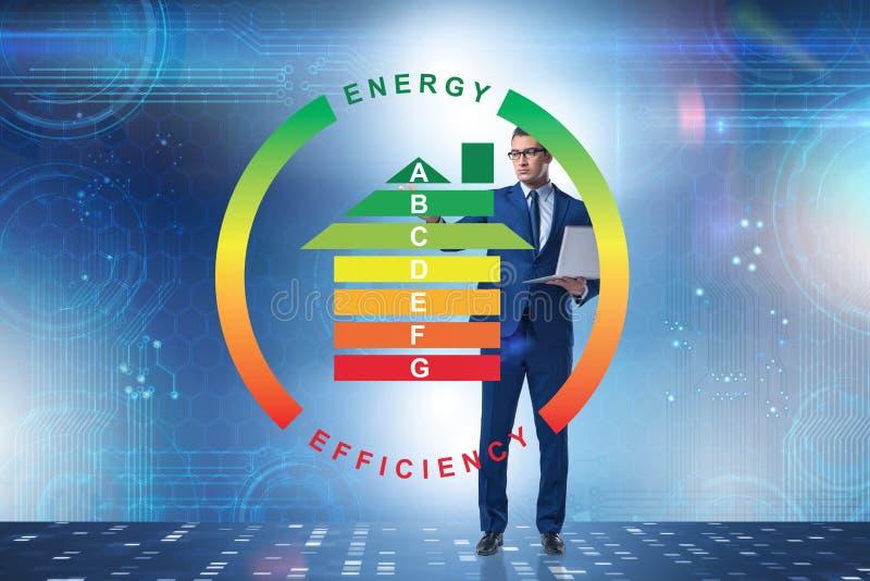 L'homme d'affaires dans le concept de rendement énergétique image stock