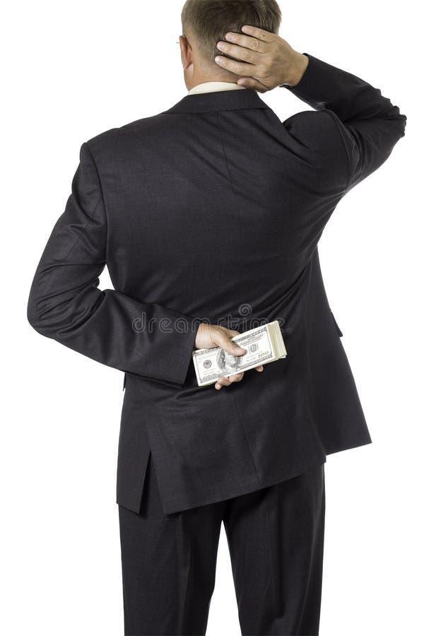 L'homme d'affaires est doute pour prendre le paiement illicite image stock