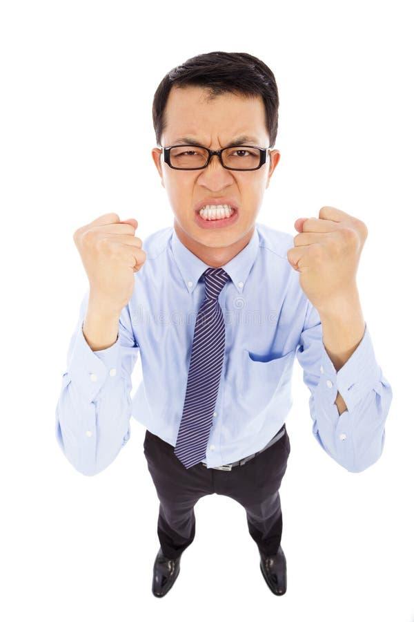 L'homme d'affaires fâché font un poing pour hurler images libres de droits
