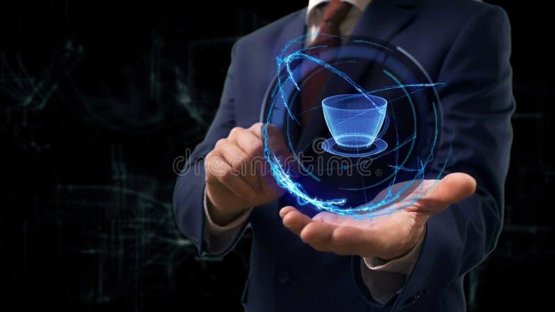 L'homme d'affaires montre la tasse de l'hologramme 3d de concept sur sa main photos libres de droits