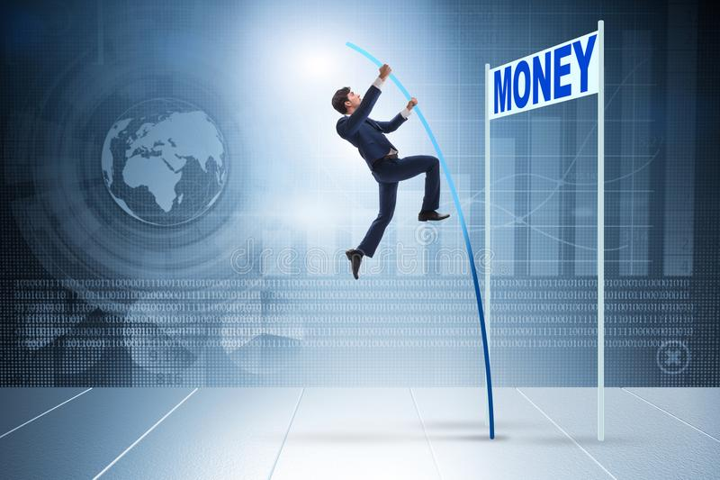 L'homme d'affaires sautant par-dessus l'argent dans le concept d'affaires images stock