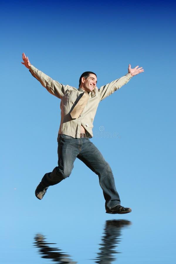 L'homme d'affaires sautant vers le haut photos stock