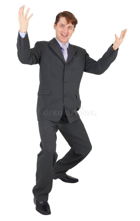 L'homme d'affaires se réjouit sur le fond blanc photo stock
