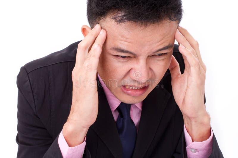 L'homme d'affaires souffre de la maladie, mal de tête grave image libre de droits