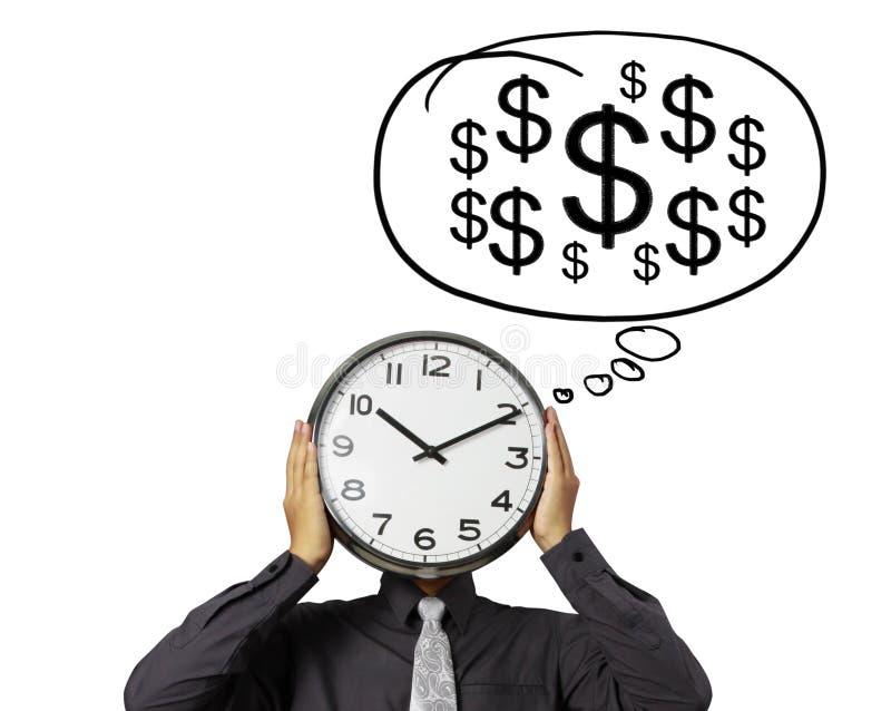 L'homme d'affaires tient l'horloge de la tête photo stock