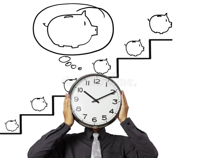 L'homme d'affaires tient l'horloge de la tête illustration libre de droits