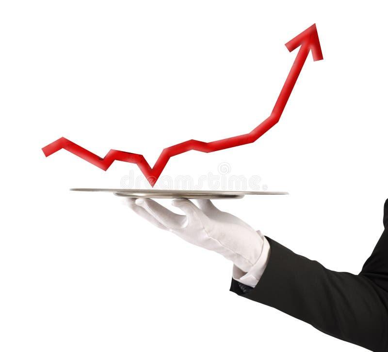 L'homme d'affaires tient un plateau avec des statistiques photos libres de droits