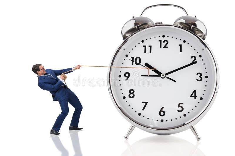 L'homme d'affaires tirant l'horloge dans le concept de temps image libre de droits