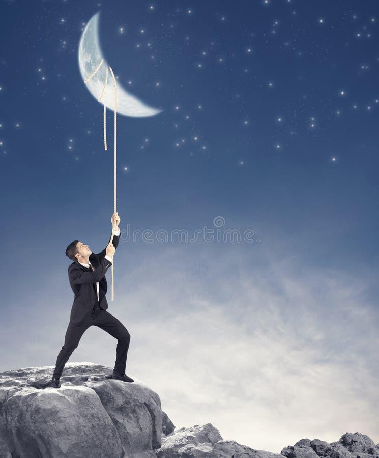 L'homme d'affaires veut la lune image libre de droits