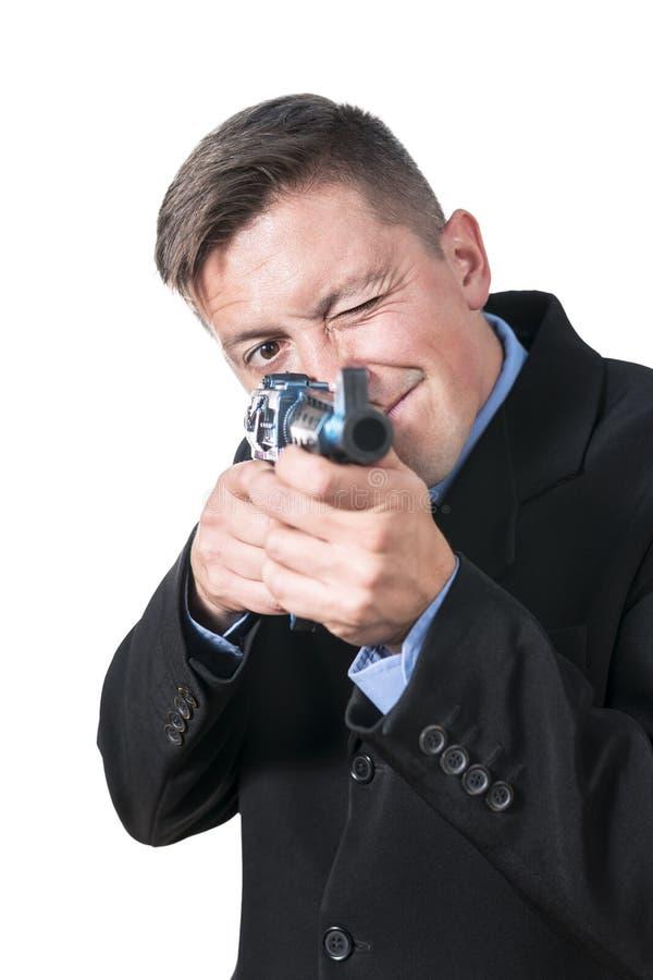 L'homme d'affaires vise avec une arme à feu images stock