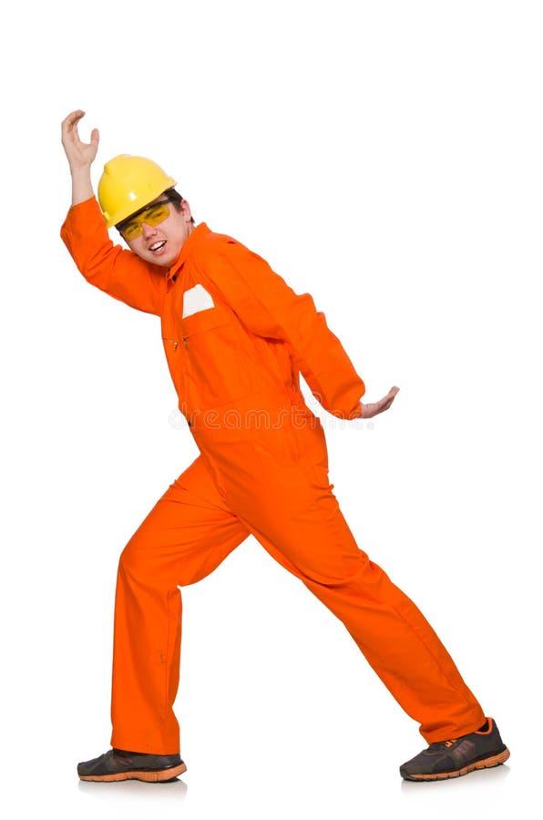 L'homme dans des combinaisons oranges d'isolement sur le blanc images stock