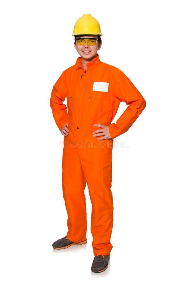 L'homme dans des combinaisons oranges d'isolement sur le blanc photo libre de droits