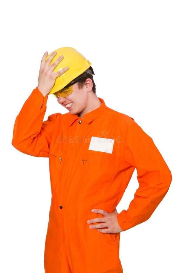L'homme dans des combinaisons oranges d'isolement sur le blanc photos libres de droits