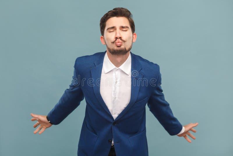 L'homme dans le costume envoient des baisers d'air images libres de droits