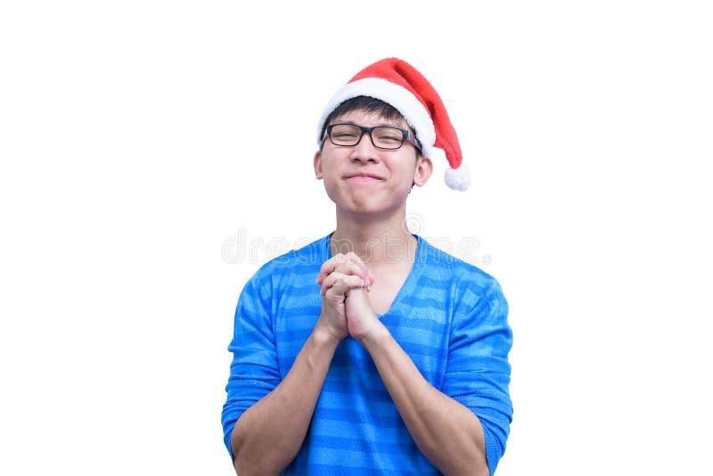 L'homme de Santa Claus d'Asiatique avec les lunettes et la chemise bleue a pour parler en faveur a photo libre de droits