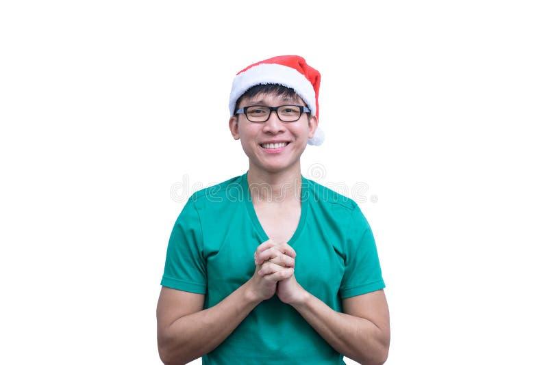 L'homme de Santa Claus d'Asiatique avec les lunettes et la chemise verte a pour parler en faveur images stock
