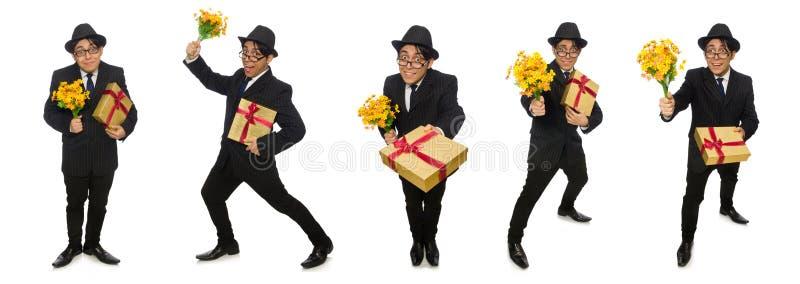 L'homme drôle avec les fleurs et le giftbox images libres de droits