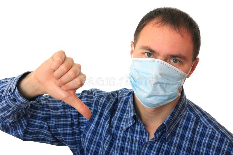 L'homme est dans le masque médical. images libres de droits