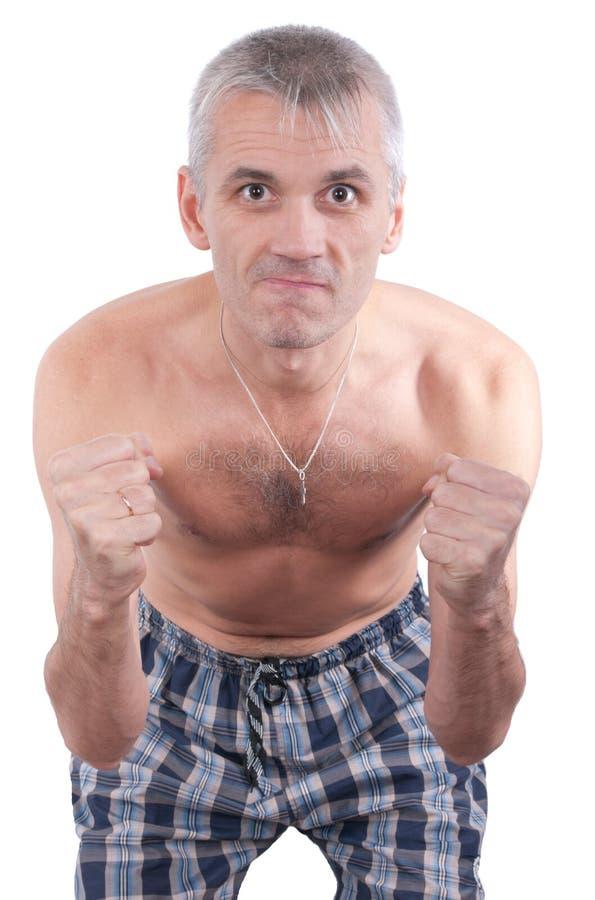 L'homme malveillant avec les poings comprimés photographie stock