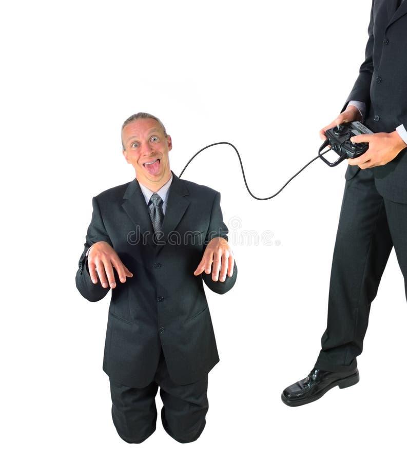 L'homme obéissant d'affaires est télécommandé photos stock