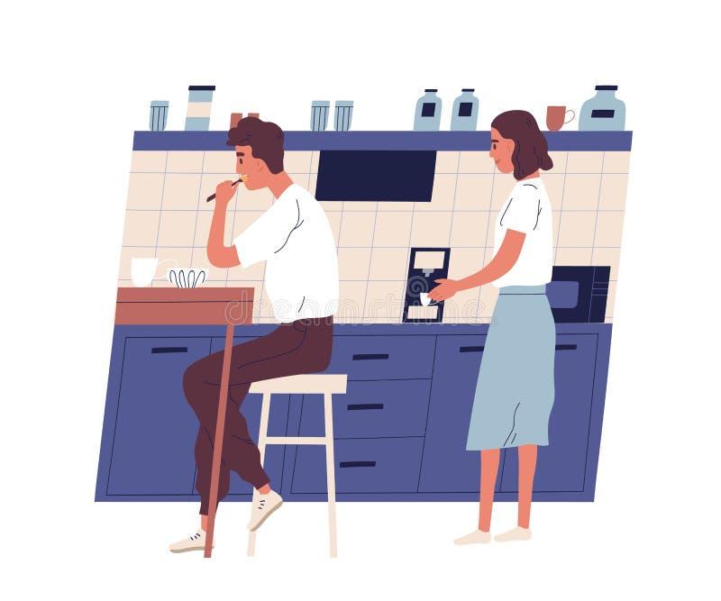 L'homme s'assied à la table dans la cuisine de bureau et mange le déjeuner tandis que son collègue utilise la machine de café Rou illustration stock