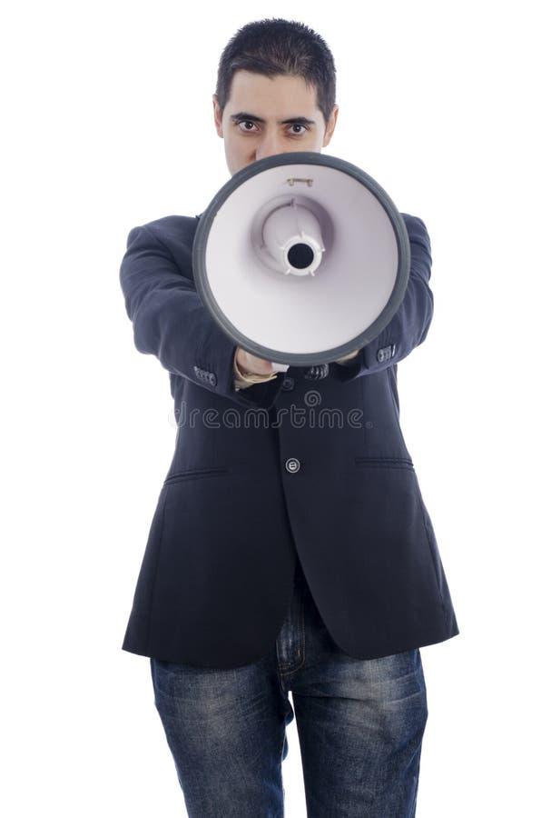 L'homme s'est habillé dans le costume et le lien criant par le mégaphone images stock