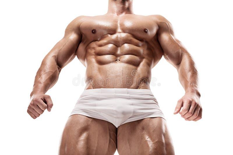L'homme sportif fort montre le corps et les muscles abdominaux photo stock