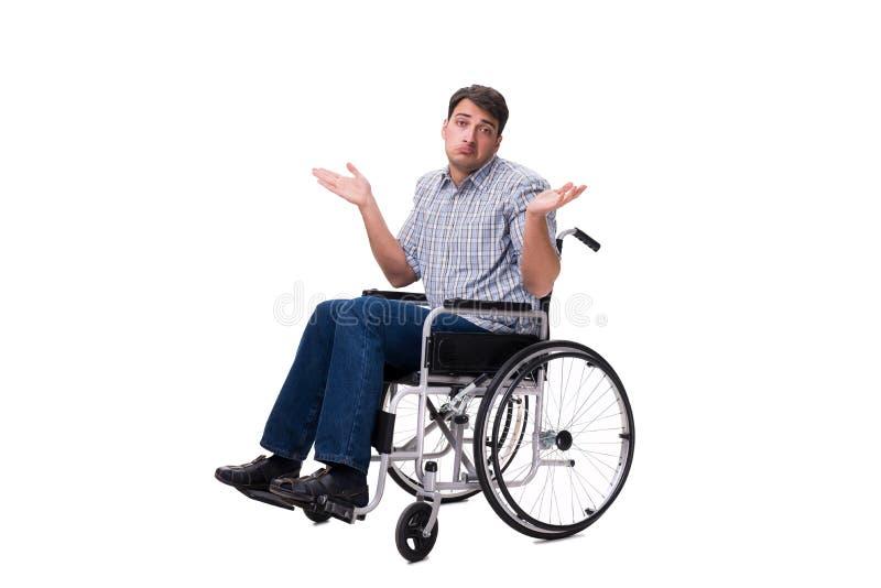 L'homme sur le fauteuil roulant d'isolement sur le fond blanc photos stock