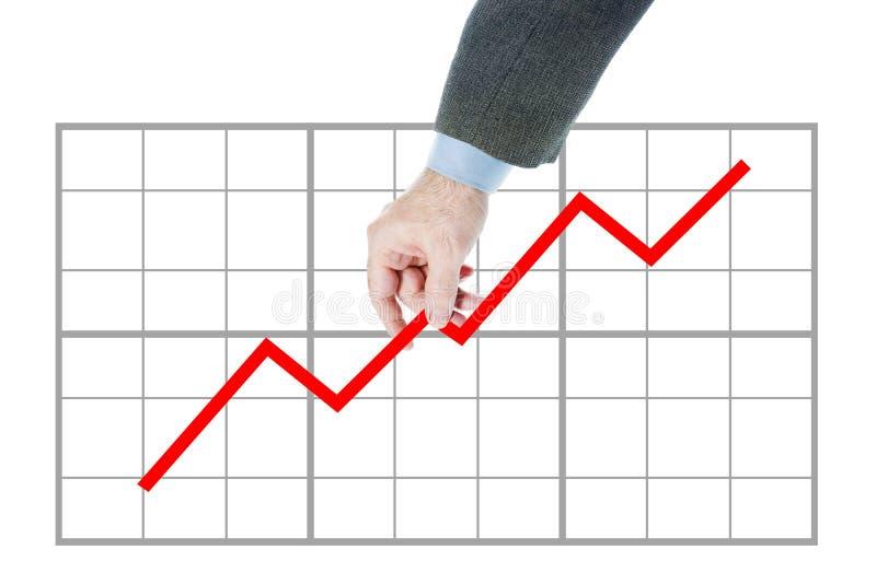 L'homme tient le diagramme allant vers le haut photographie stock