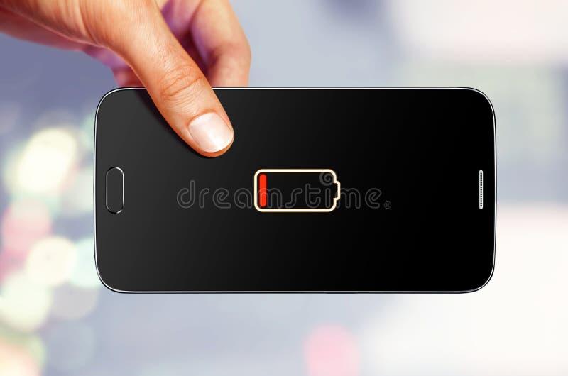 L'homme tient le périphérique mobile image libre de droits
