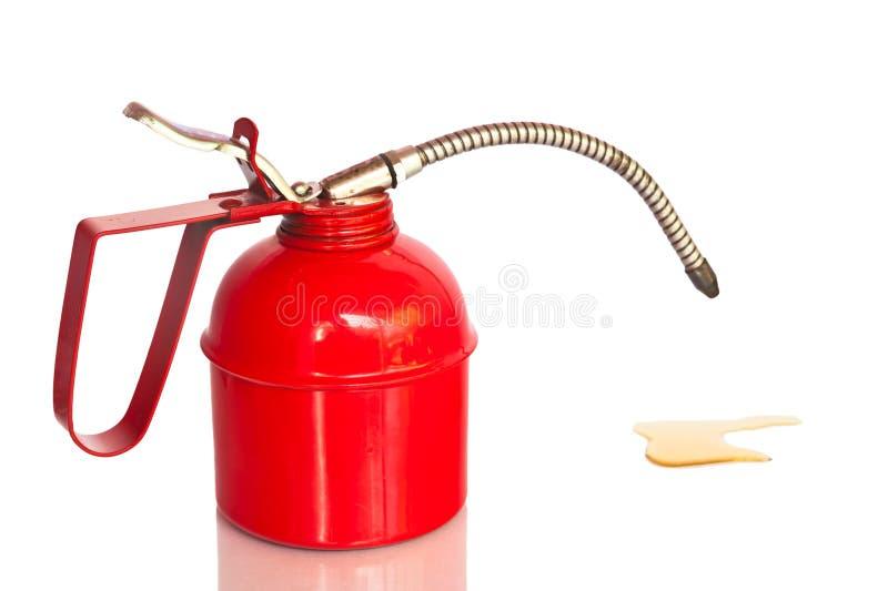 L'huile rouge peut, d'isolement, des chemins de coupure image libre de droits