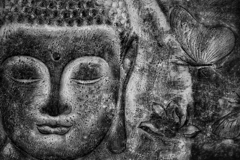 L'image Bouddha de mur font face, image noire et blanche photos stock