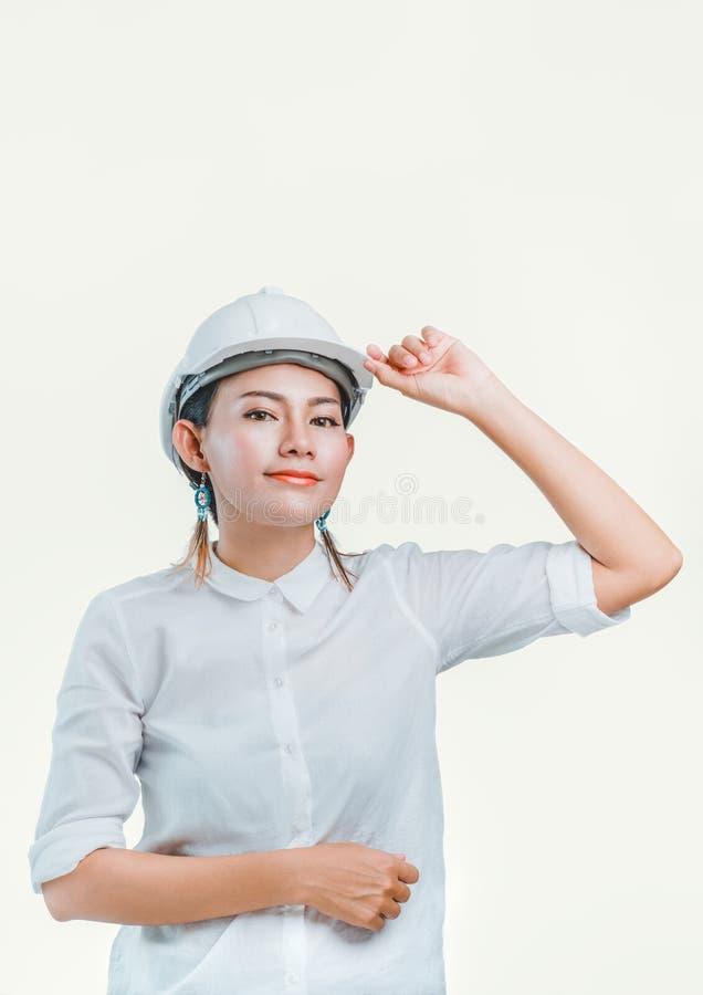 L'image de la femme asiatique de fond blanc porte la sécurité photo stock