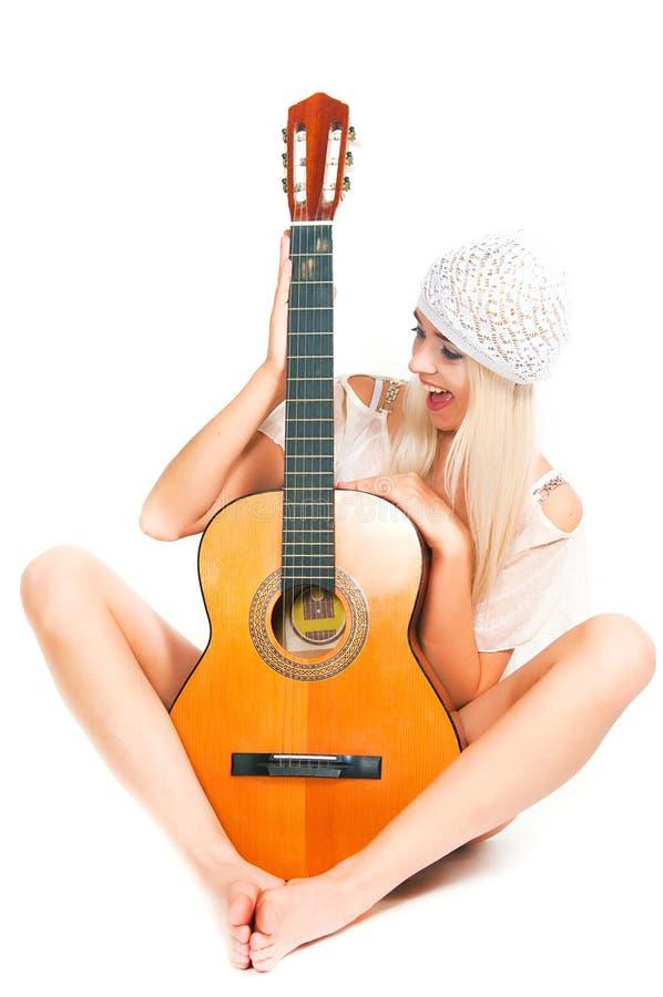 L'image de la fille avec une guitare photographie stock