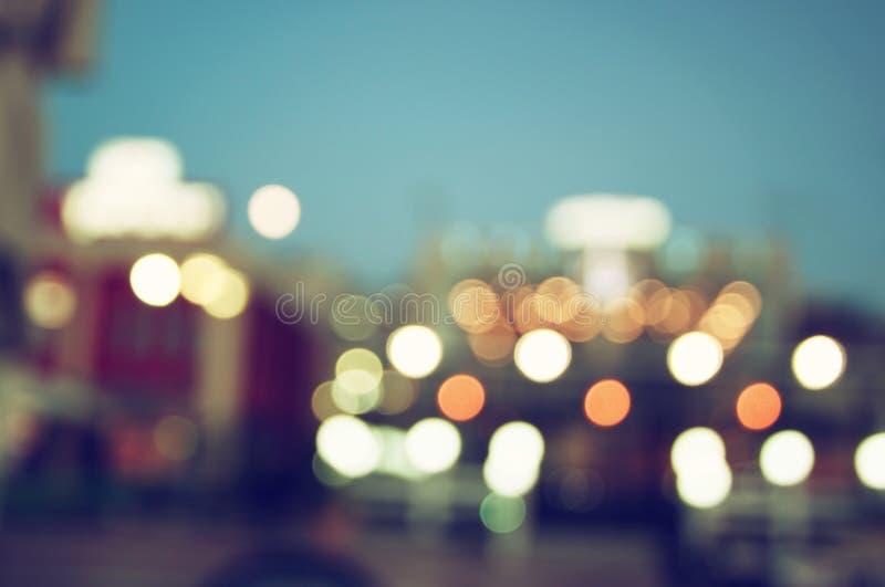 L'immagine astratta del fondo vago della città di notte con il cerchio si accende immagini stock libere da diritti
