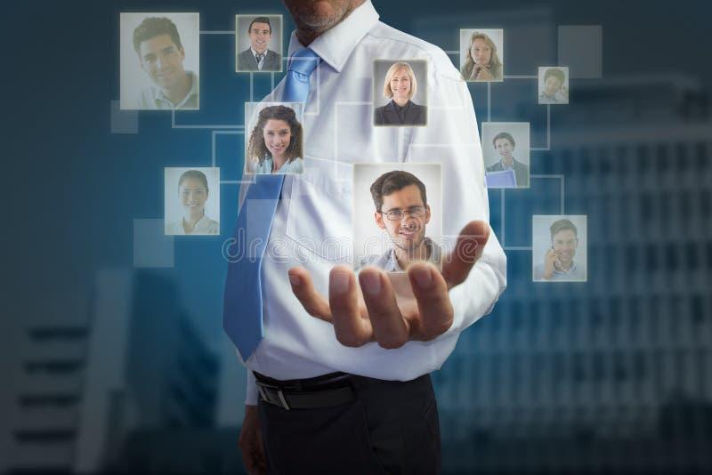 L'immagine composita della tenuta dell'uomo d'affari distribuisce immagine stock libera da diritti