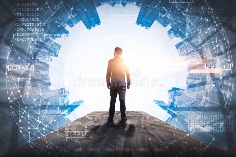 L'immagine di doppia esposizione dell'uomo di affari che sta indietro durante la sovrapposizione di alba con l'immagine futuristi fotografie stock libere da diritti