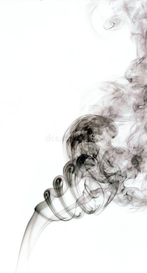 L'immagine di fumo su fondo bianco immagini stock libere da diritti