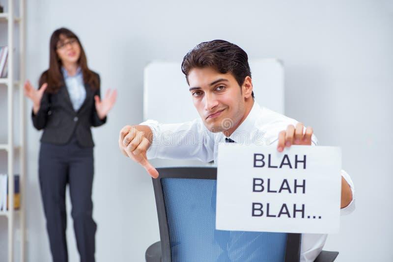 L'impiegato annoiato alla presentazione di affari fotografia stock libera da diritti
