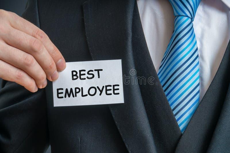 L'impiegato sicuro di sé è indicando ad etichetta che è il migliore impiegato fotografie stock