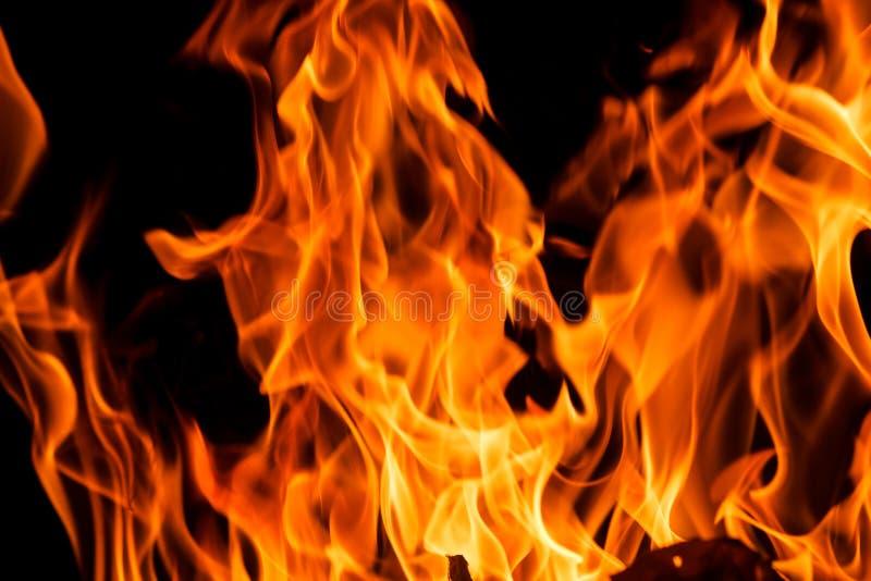 l'incendie de fond flambe le grand dos orange image libre de droits