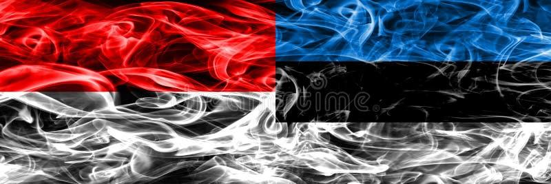 L'Indonesia contro le bandiere del fumo dell'Estonia disposte parallelamente Colo spesso fotografia stock libera da diritti
