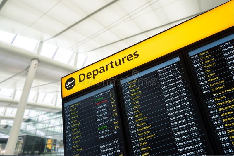 L'information de vol, arrivée, départ à l'aéroport, Londres images libres de droits