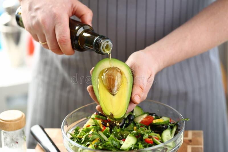 L'ingrediente esotico del seme dell'avocado ha versato Olive Oil fotografia stock