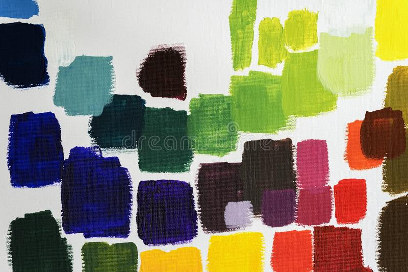 L'insieme dei colpi variopinti fatti a mano su tela, colori differenti, tavolozza dell'artista, spruzza, struttura, per creativo  fotografia stock