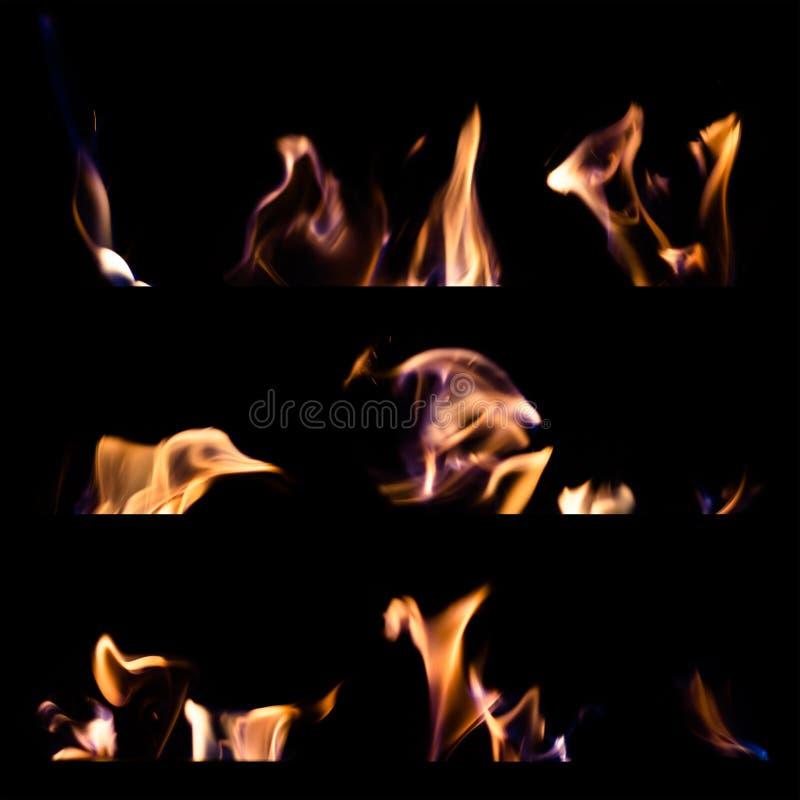 L'insieme delle fiamme del fuoco ha isolato il fondo nero immagine stock